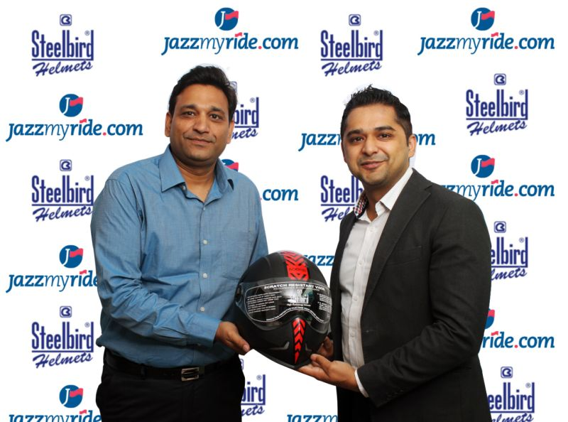 LtoR Shailendra Jain, Group Head Sales & Marketing Steelbird Helmets with Mr Sunil Dhingra Founder & CEO, Jazzmyride.com annoucing the tie  up web