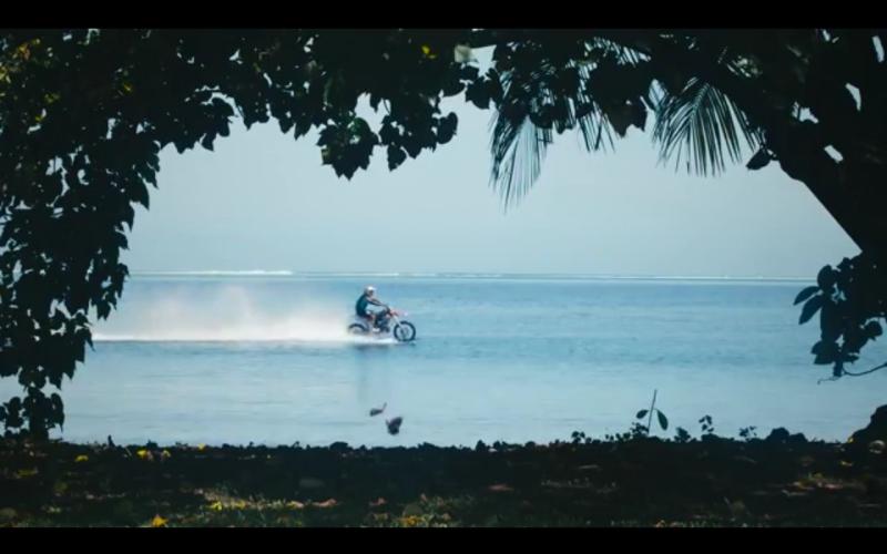 Robbie Maddison surfs with KTM in Tahiti web