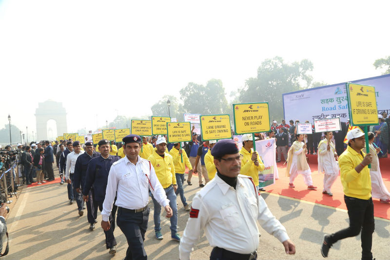 JK Tyre volunteers and Delhi Traffic Police at Road Safety Walk to celebrate the National Road Safety Week in Delhi on Monday web