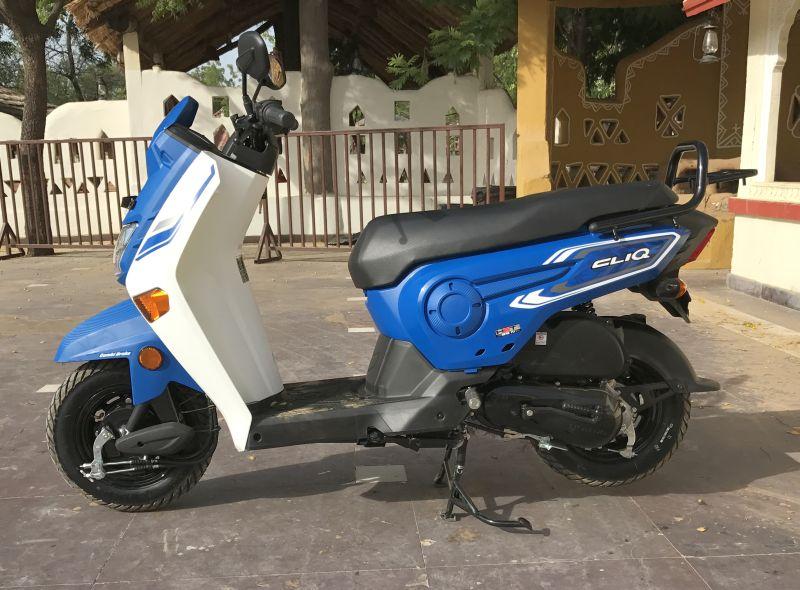 side of blue honda cliq 110 cc scooter