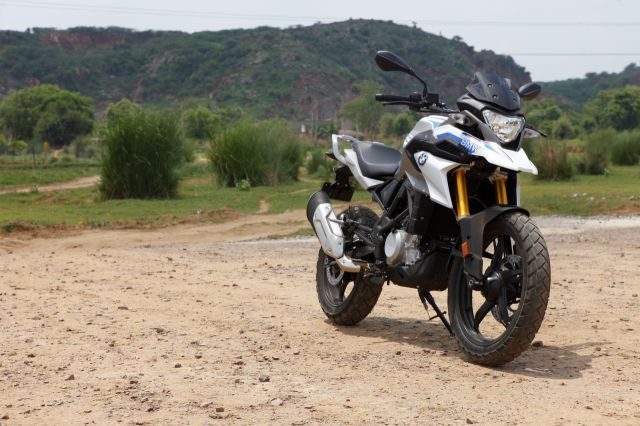 The GS has more suspension travel and better ground clearance than the G 310 R