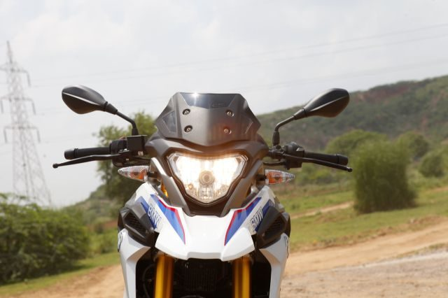 The triabgle headlight shape and tall design comeplete BMW G310 GS's adventure bike stance