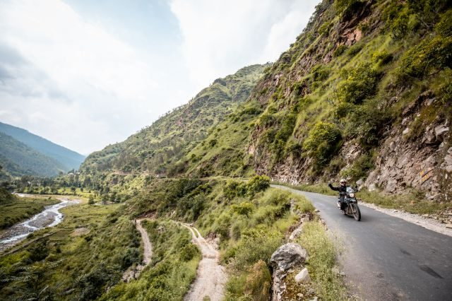 Royal Enfield Unroad Himachal - A rider en route to a water crossing at the bootom of a valley