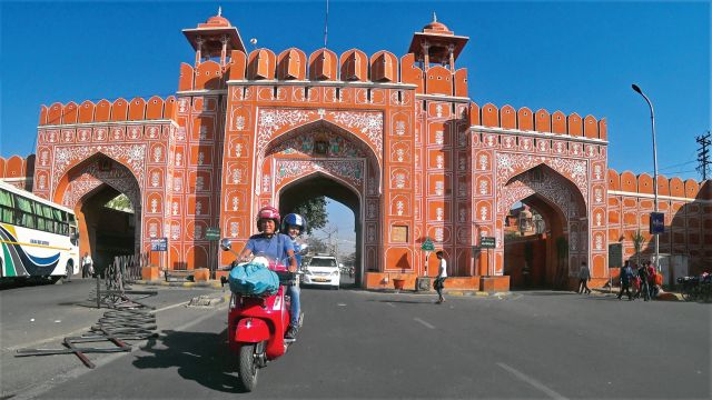Three travellers set out from Berlin astride bright red Vespas to reach Goa in time for the full moon festival